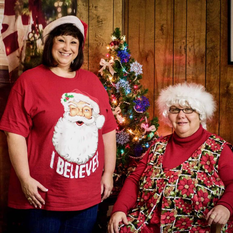 Angie and Mrs Claus at Christmas party