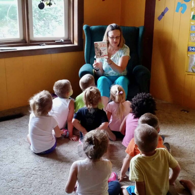 Karen Long reads book to children at library