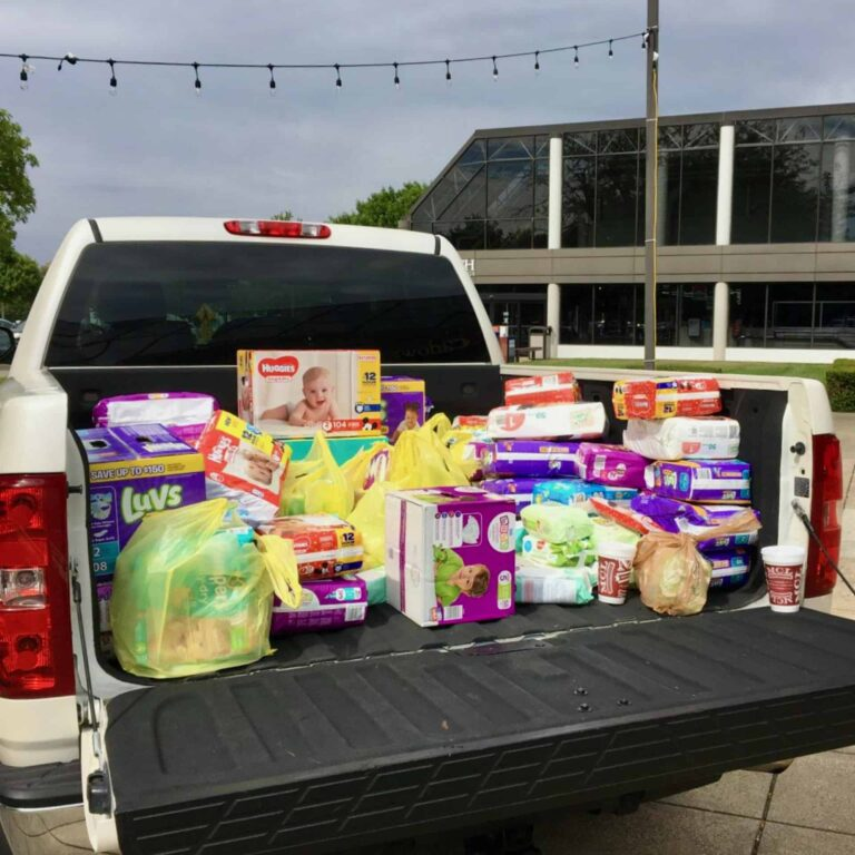 pickup truck filled with diaper donations at Stuff the Truck Diaper Drive